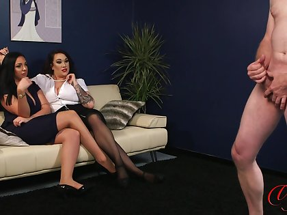Pornstars Amelia Brookes and Bex Shiner watch a guy jerk elsewhere