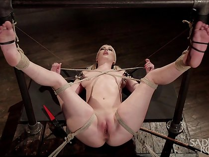 Busty blonde appears fully exposed for a wild bondage play